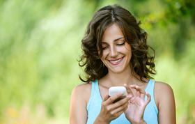 Happy lady with phone smaller