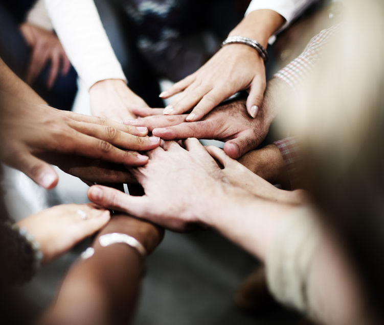 53104463 - team teamwork join hands partnership concept