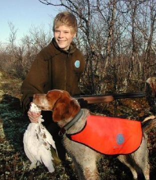 Ung jeger med hund - foto:Rolf Kollstrøm/FeFo