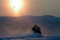 Snowmobile in sunset