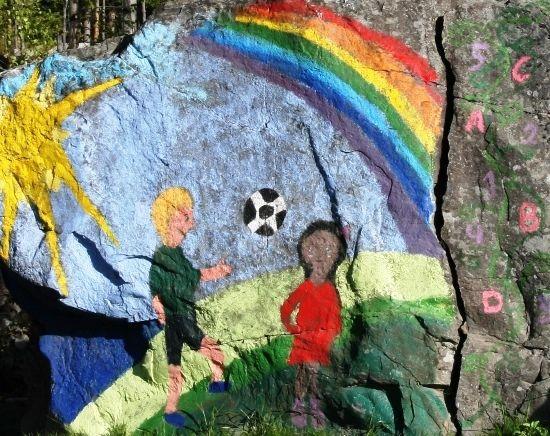 Maleri av barn og regnbue