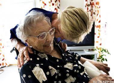 Helsearbeider sammen med pasient