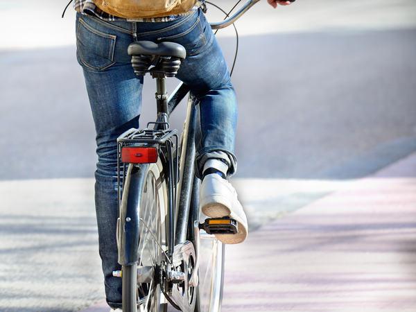 Man on bike on his way home