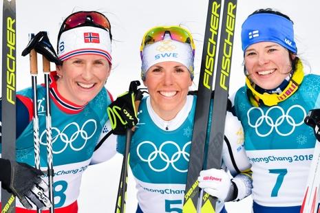 Medaljtrion Björgen, Kalla och Pärmäkoski. FOTO: Petter Arvidsson/Bildbyrån.