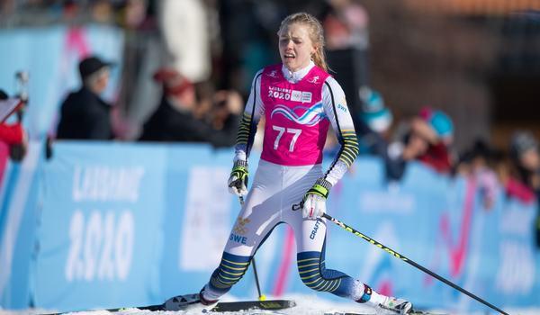 Märta Rosenberg i mål som vinnare på 5 kilometer klassiskt vid ungdoms-OS i Lausanne, Schweiz. FOTO: Bildbyrån - IOS/Joel Marklund.